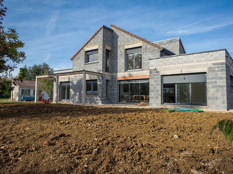 Photo d'illustration : travaux de terrassement durant une construction de maison